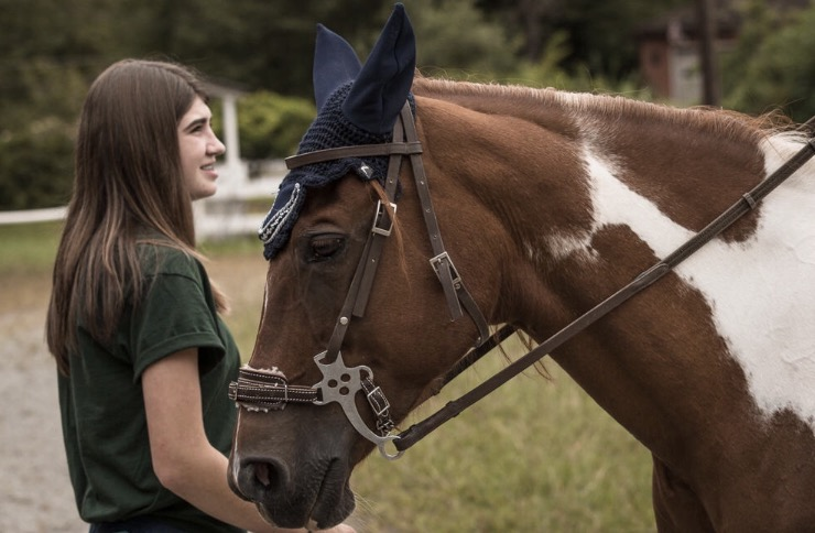 club member and horse
