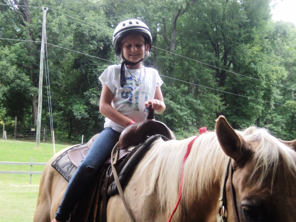 Image of a child on a horse