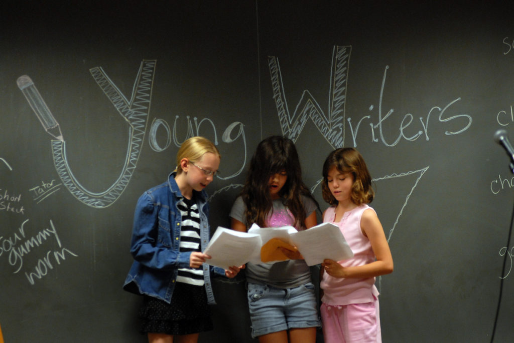 Elementary school students perform a play