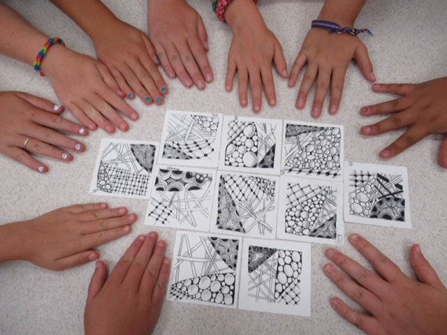 Image of hands on a table