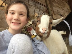 Image of girl with goat
