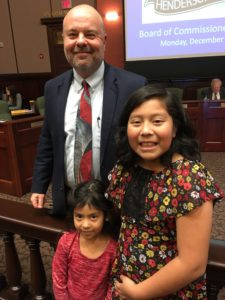 Imge of Allison and Hazel Trejo with County Manager Steve Wyatt