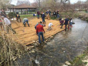 volunteers repairing stream