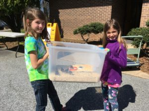 Alyssa and Airely with brooder box