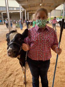 Randi Mae Eatmon with her dairy steer