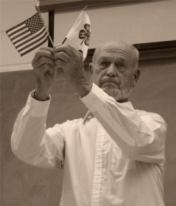 Earl Smith holding the American and 4-H flags.